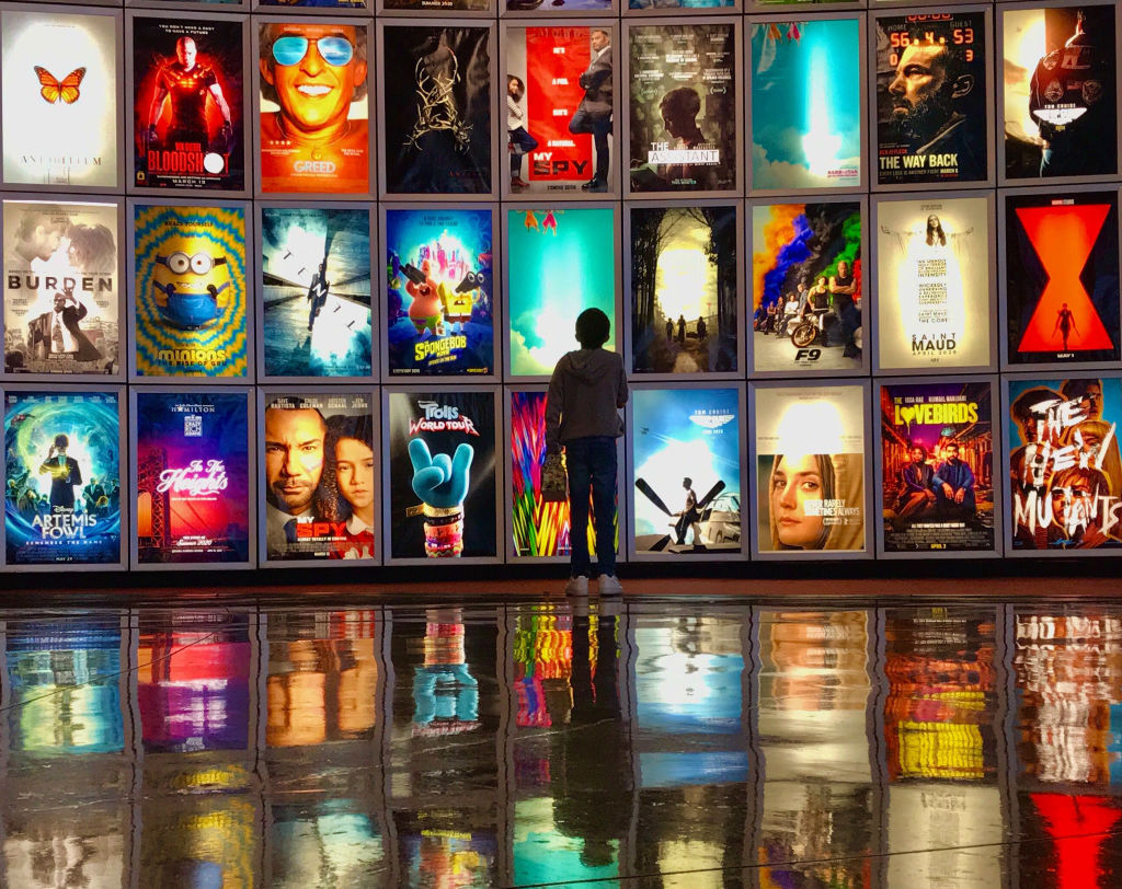 A child looks at movie posters inside the lobby of the Arclight movie theater in Manhattan Beach, Ca., on March 12, 2020.
