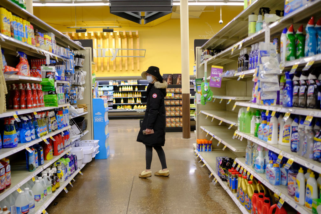 A woman wearing a mask shops for cleaning supplies at a Kroger in Bloomington.