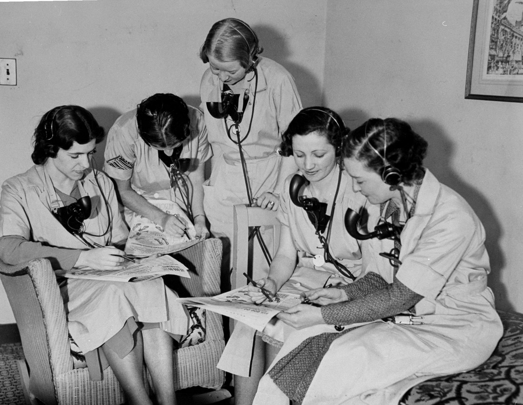 Phone operators at the New Yorker Hotel work on a Daily News Crossword Puzzle Contest in 1934