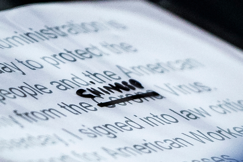 A close-up of President Trump's notes shows where the word  Corona  was crossed out and replaced with  Chinese  during a briefing at the White House on March 19, 2020.