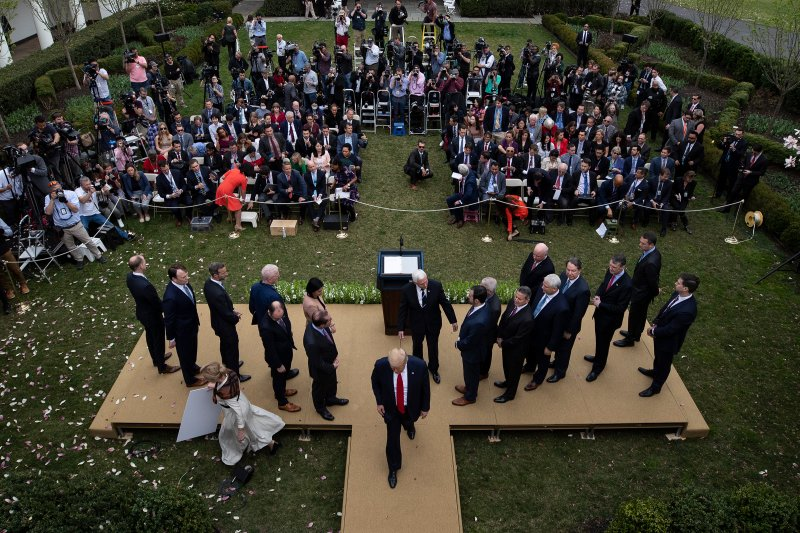 President Trump leaves the podium after announcing a national emergency during a news conference about the coronavirus at the White House in Washington, D.C., on March 13.