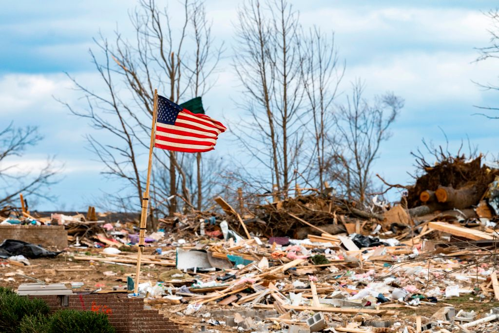 A flag flaps in the wind as President Donald Trump tours tornado damage in Cookeville, Tennessee on March 6, 2020.