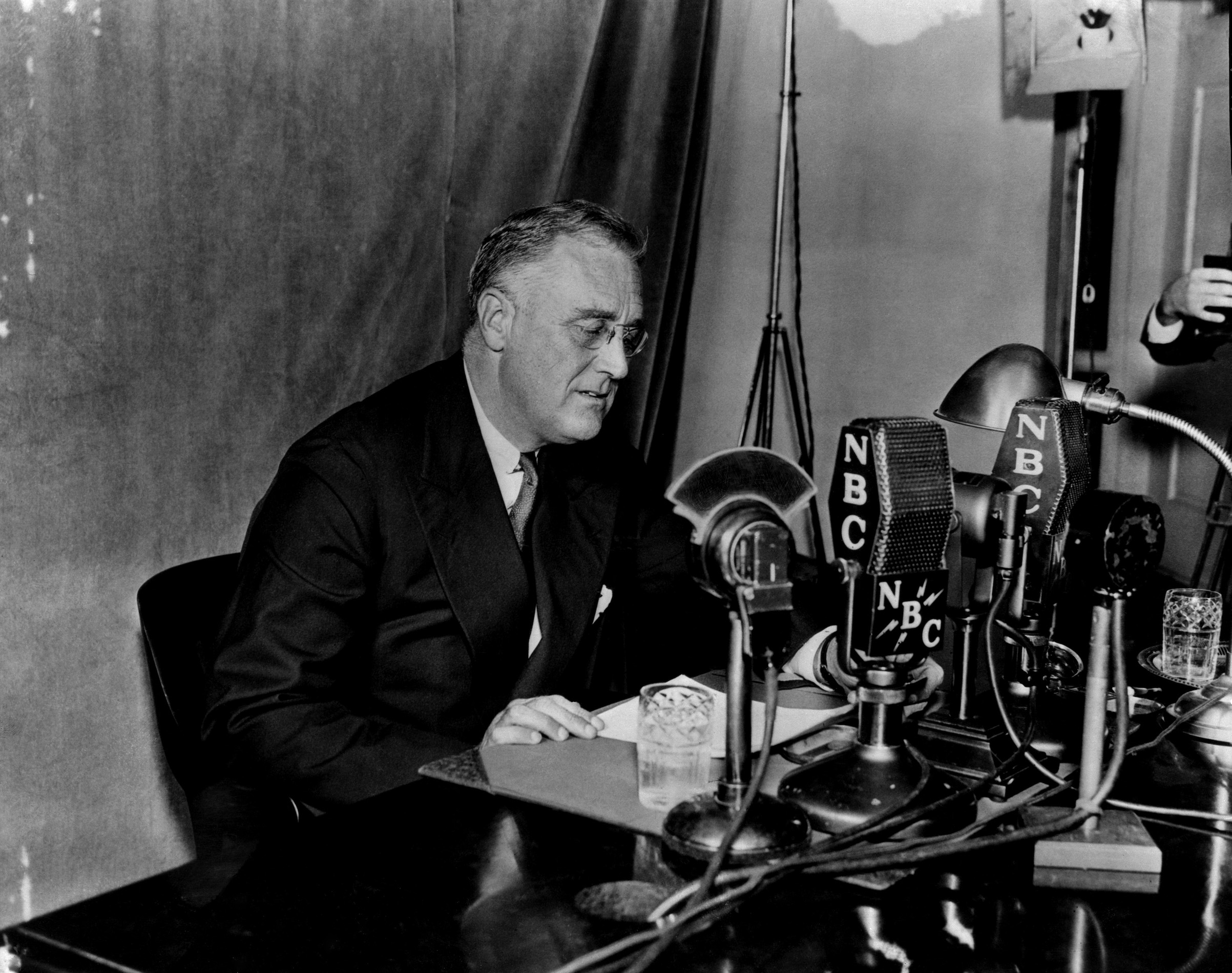 President Franklin D. Roosevelt during one of his  fireside chats  broadcasted on NBC Radio