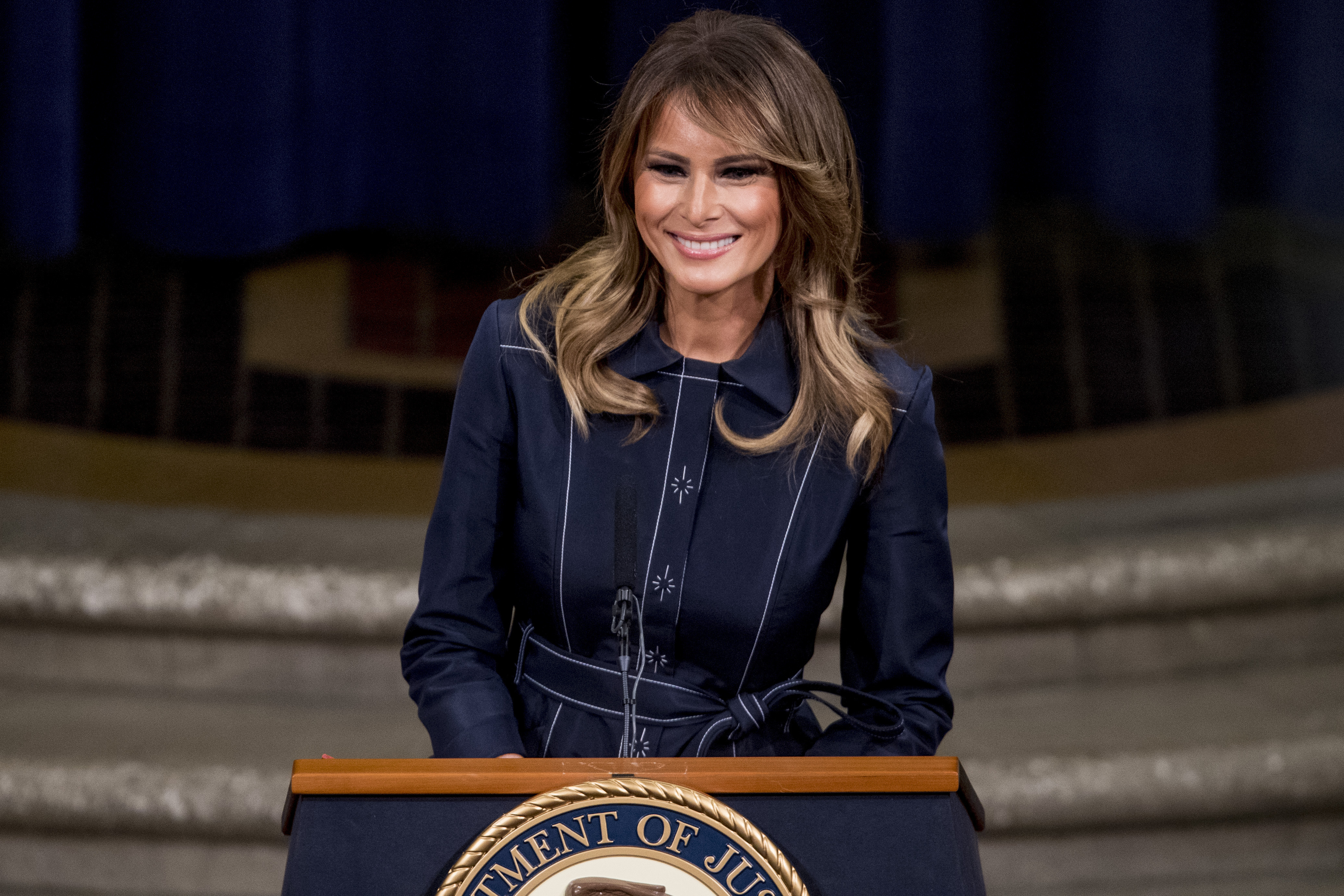 First lady Melania Trump smiles during a speech at the Justice Department's National Opioid Summit at the Department of Justice, on March 6, 2020, in Washington.