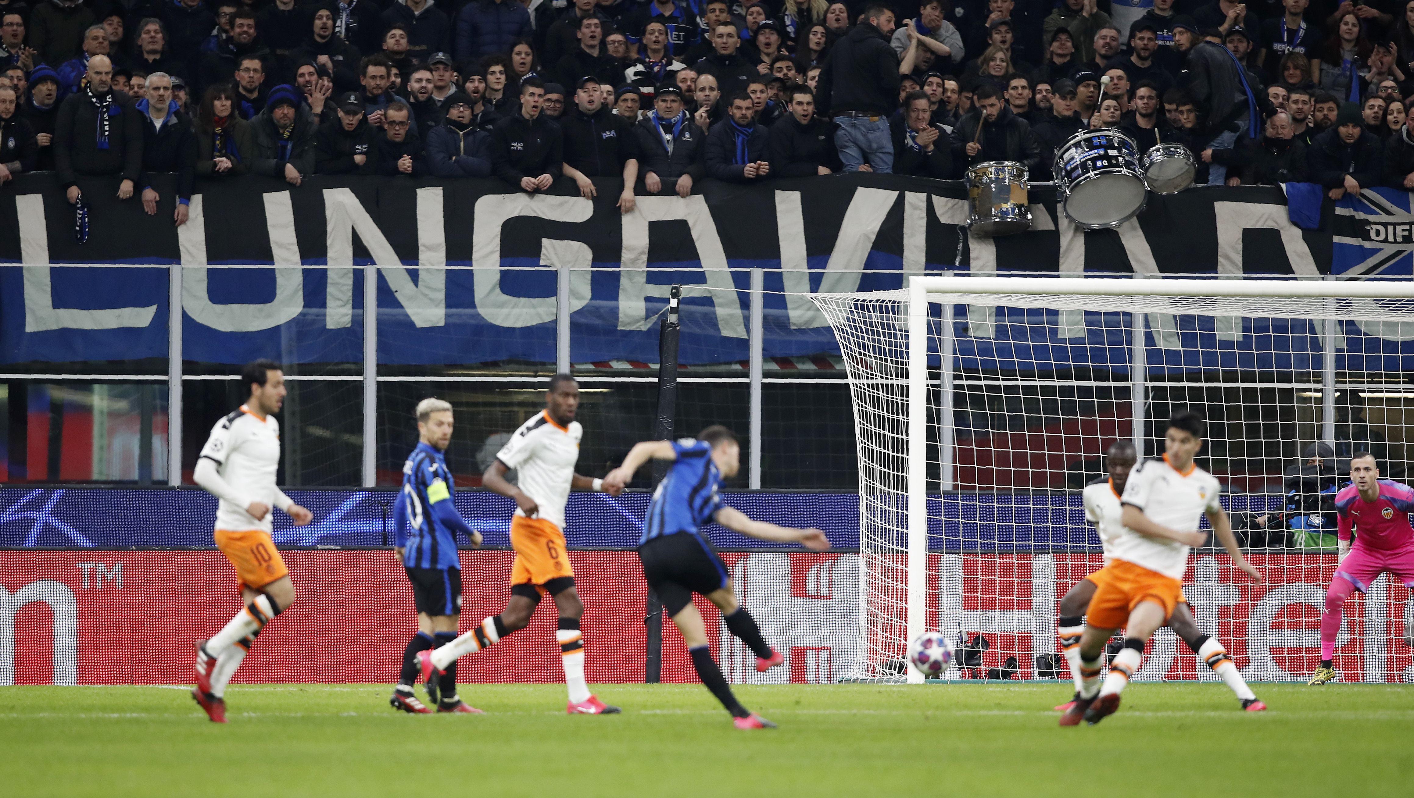 In this Wednesday, Feb. 19, 2020 file photo, spectators sit in the stands during the Champions League round of 16, first leg, soccer match between Atalanta and Valencia at the San Siro stadium in Milan, Italy. It was the biggest soccer game in Atalanta's history and a third of Bergamo's population made the short trip to Milan's famed San Siro Stadium to witness it.