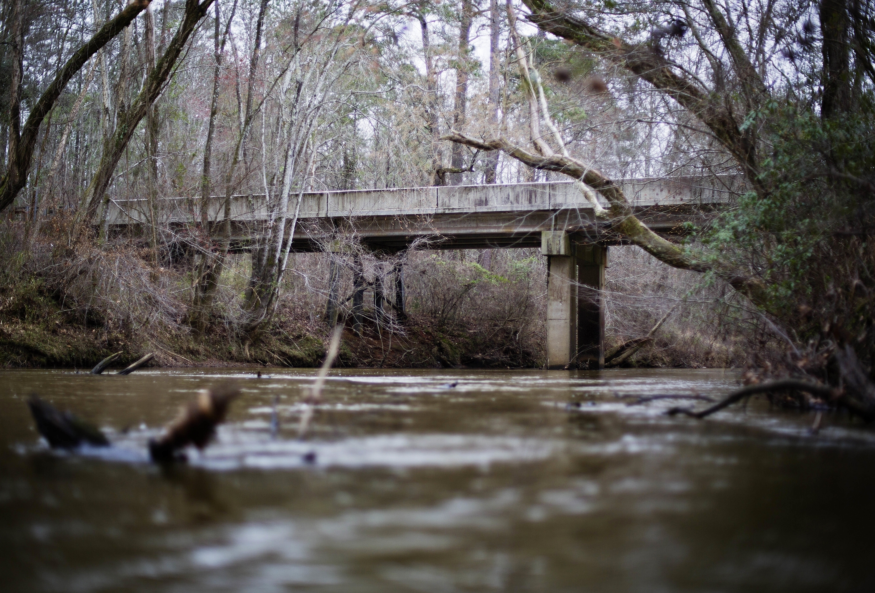 This Feb. 22, 2018 file photo shows a bridge that spans the Apalachee River at Moore's Ford Road where in 1946 two young black couples were stopped by a white mob who dragged them to the riverbank and shot them multiple times in Monroe, Ga.