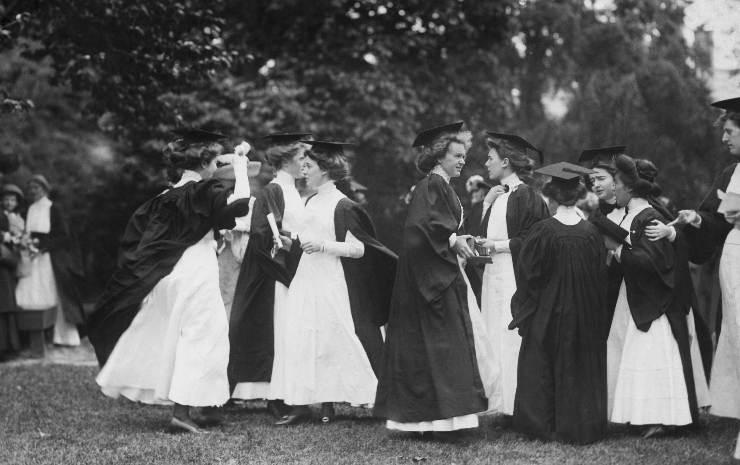 Women graduates exiting after a graduation ceremony. Photograph, ca. 1900.