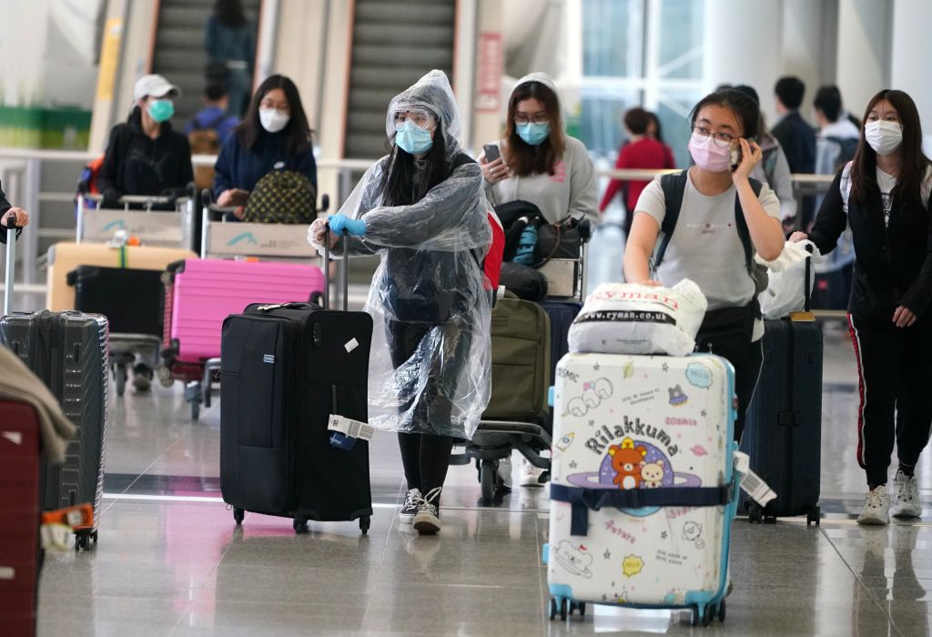 Travelers arrive at Hong Kong International Airport in Hong Kong on Mar. 18, 2020.