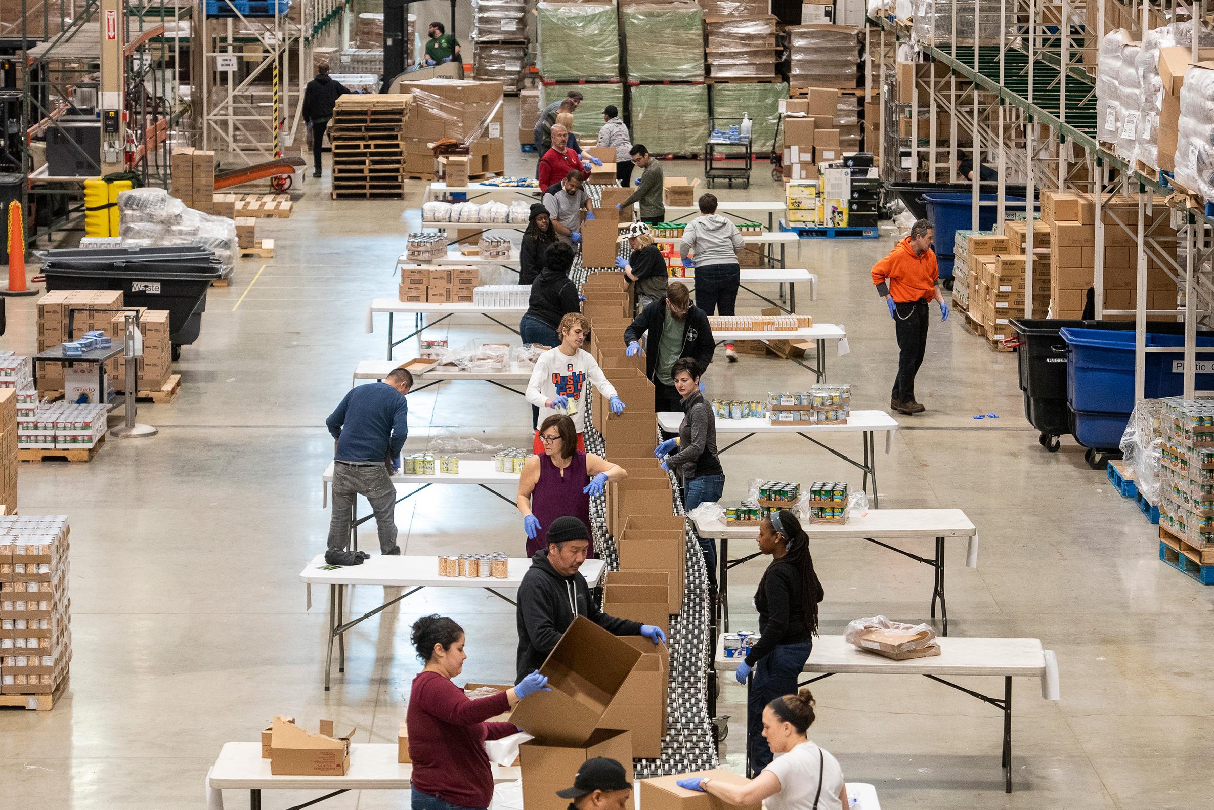 Volunteers help break down and repackage food at the Greater Chicago Food Depository on Mar. 24