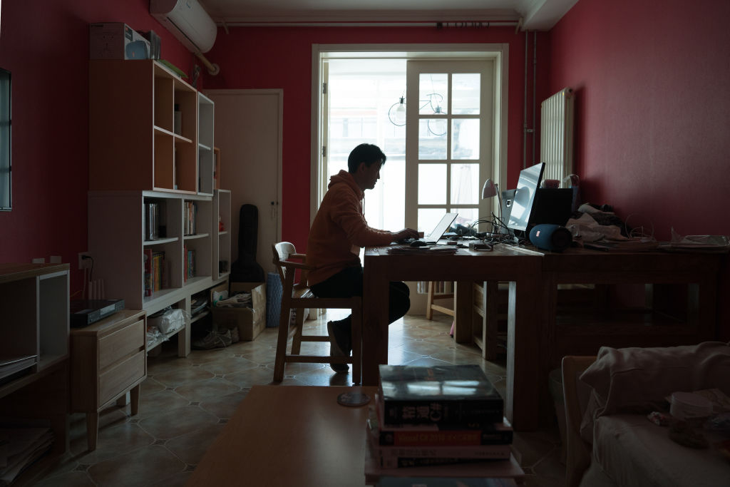 Michael Wang, 49, IT worker from Beijing, works on the laptop in his house on March 4, 2020 in Beijing, China.