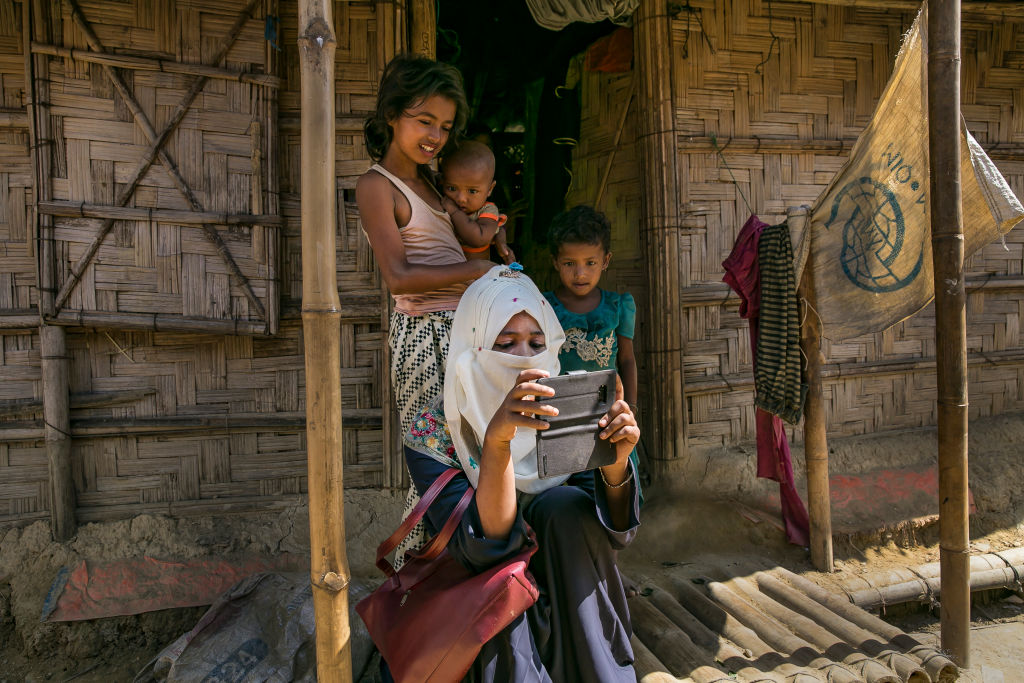 Omal Khair takes photos in a Rohingya refugee camp in Cox's Bazar, Bangladesh on Oct. 28, 2019.