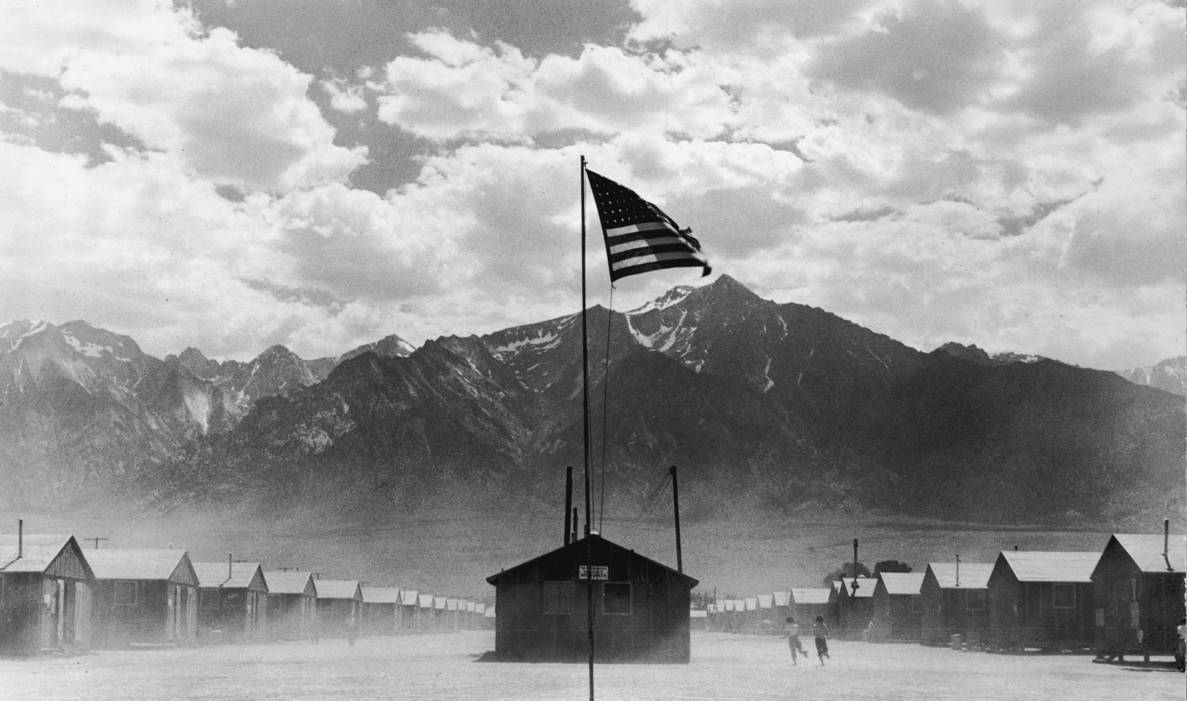A U.S. flag flies at a Japanese-American detention camp in Manzanar, Calif., in 1942