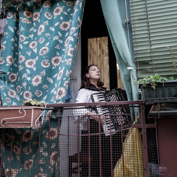 Citizens of Milan take to their balconies on March13 to serenade their neighbors; 10 days later, Italy had nearly 70,000 confirmed cases of COVID-19 and almost 7,000 dead