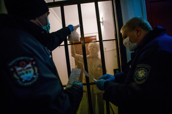 In Budapest, civil guards deliver food to the homebound