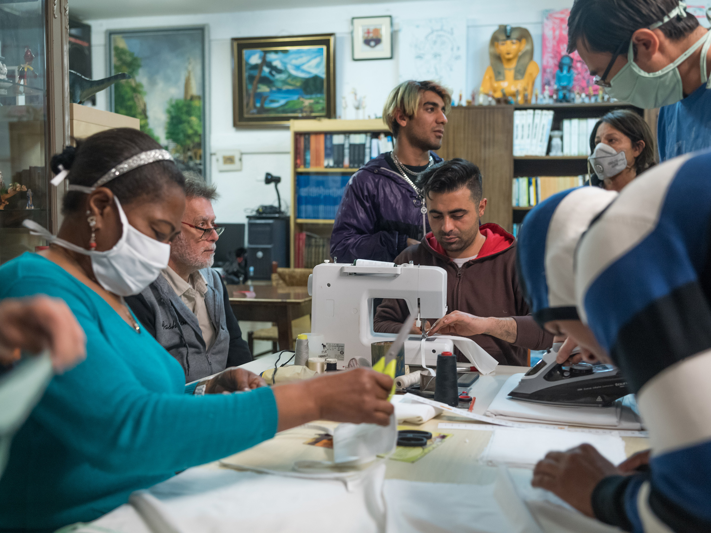 Residents of Casa Cádiz, a shelter for homeless people and refugees in Barcelona, produce face masks for use in hospitals and nursing homes