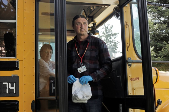 Matt Remle, a Native liaison with the now shut-down Marysville School District, delivers sack lunches to students on the Tulalip Indian Reservation