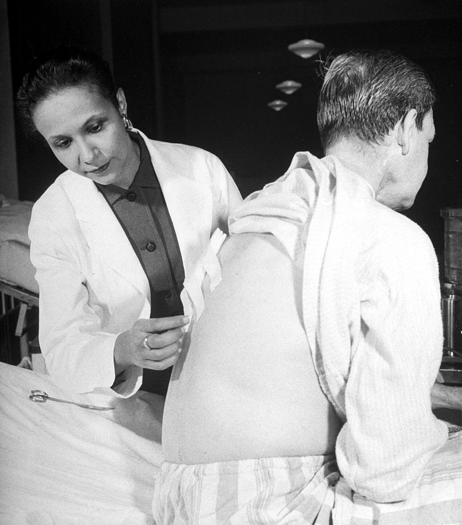 A photo in the Dec. 24, 1956, issue of LIFE magazine shows Dr. Jane Wright (L), head of cancer research, examining a patient at the Manhattan hospital Bellevue.