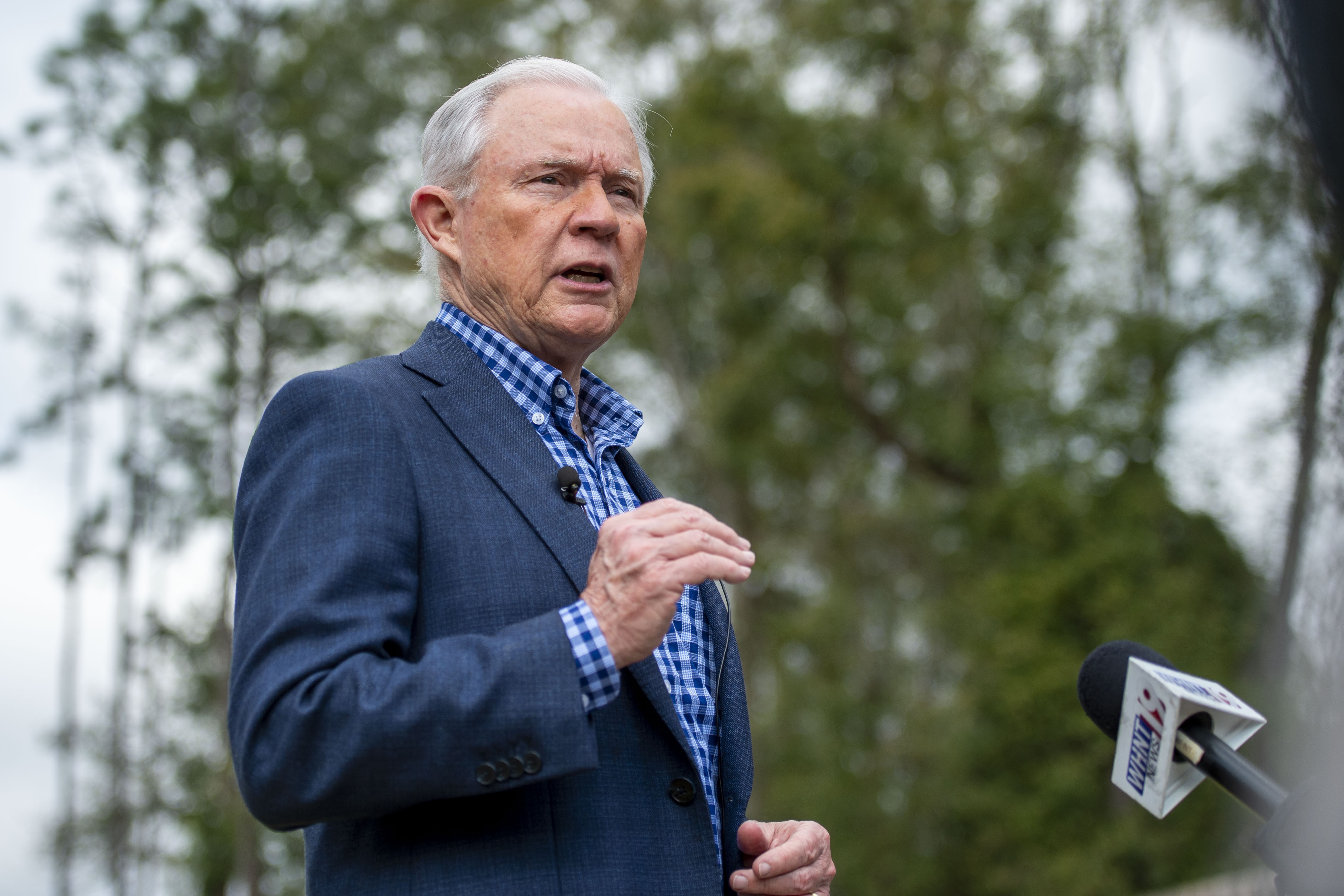 Jeff Sessions speaks with reporters after voting in Alabama's primary election in Mobile, Ala. on Mar. 3, 2020.