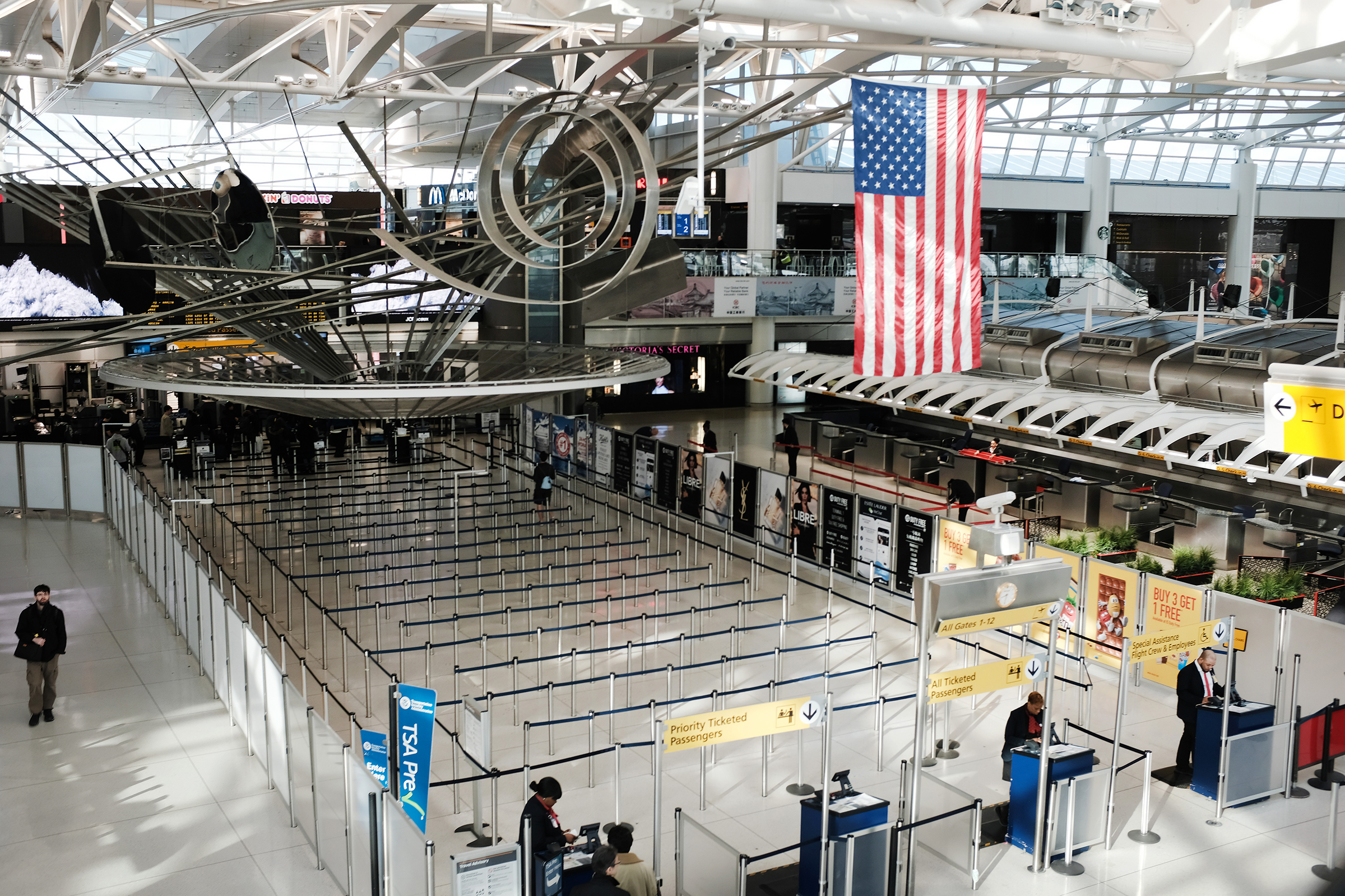 A sparse international departures terminal at John F. Kennedy International Airport in New York City on March 7. Days later, as concerns over the coronavirus grew, President Trump announced restrictions on travelers from Europe.