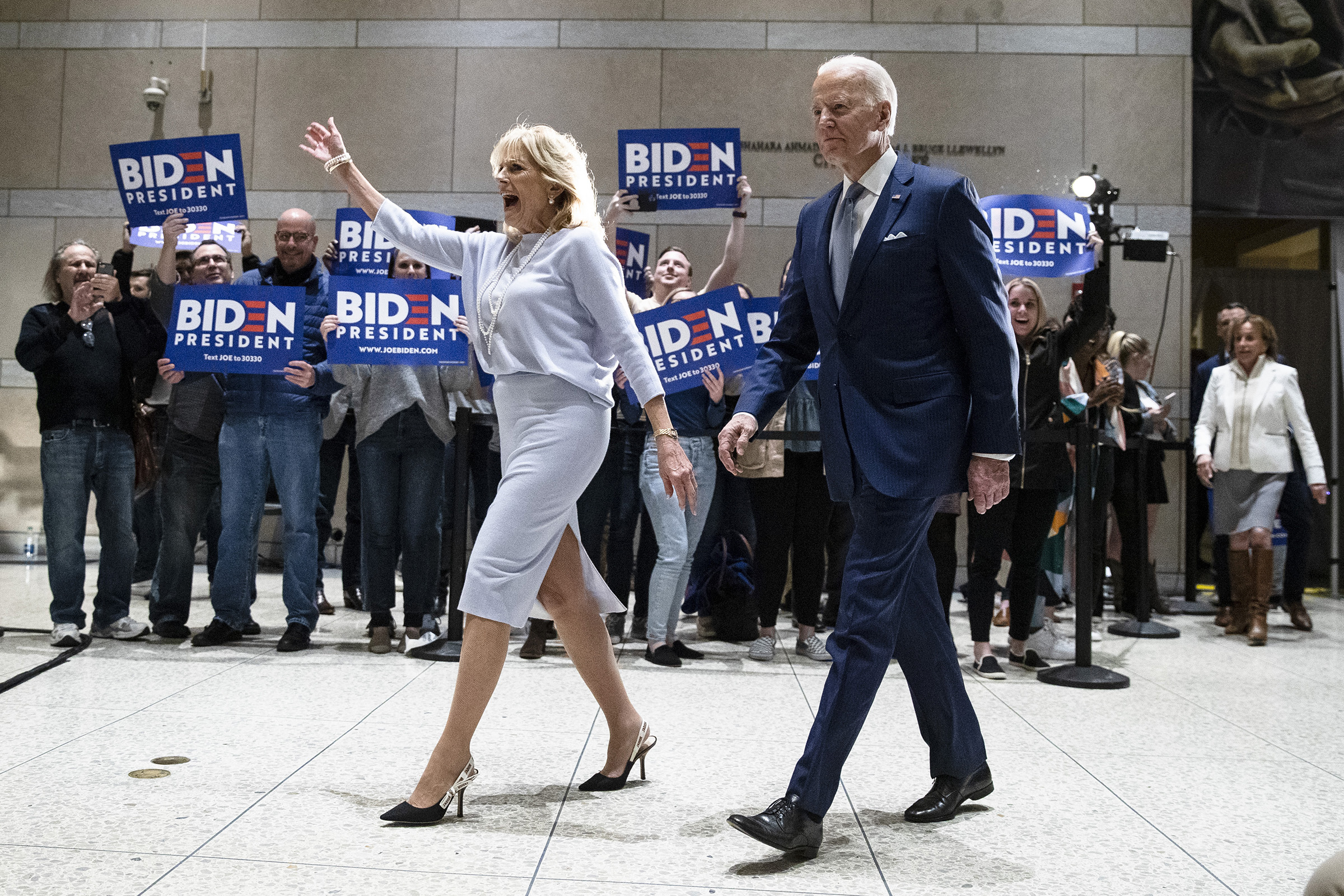 Democratic presidential candidate former Vice President Joe Biden, accompanied by his wife Jill arrives to speak to members of the press at the National Constitution Center in Philadelphia, on March 10, 2020.