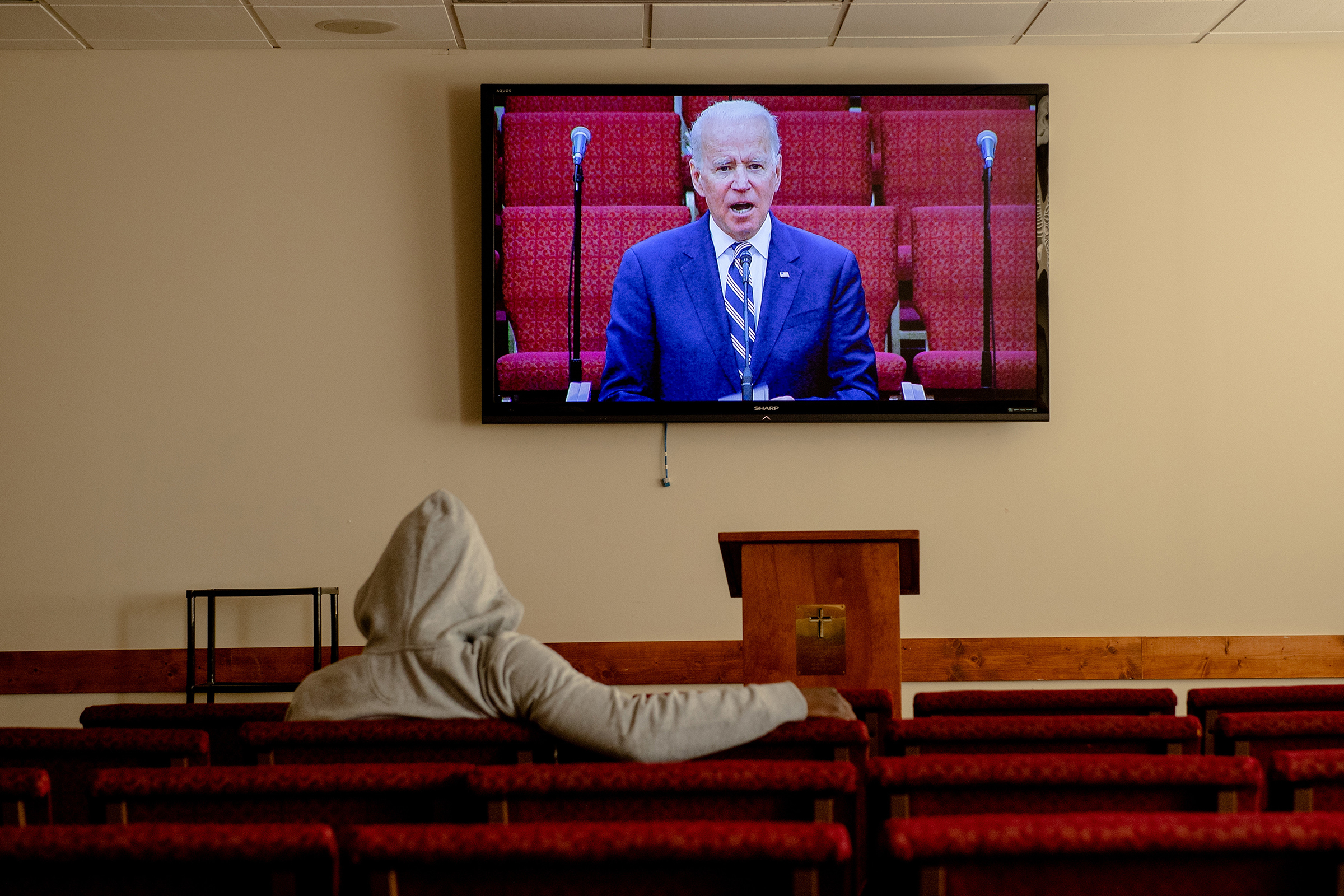 A screen shows Democratic presidential candidate Joe Biden during a service at Royal Missionary Baptist Church in North Charleston, S.C., on Feb. 23, 2020.