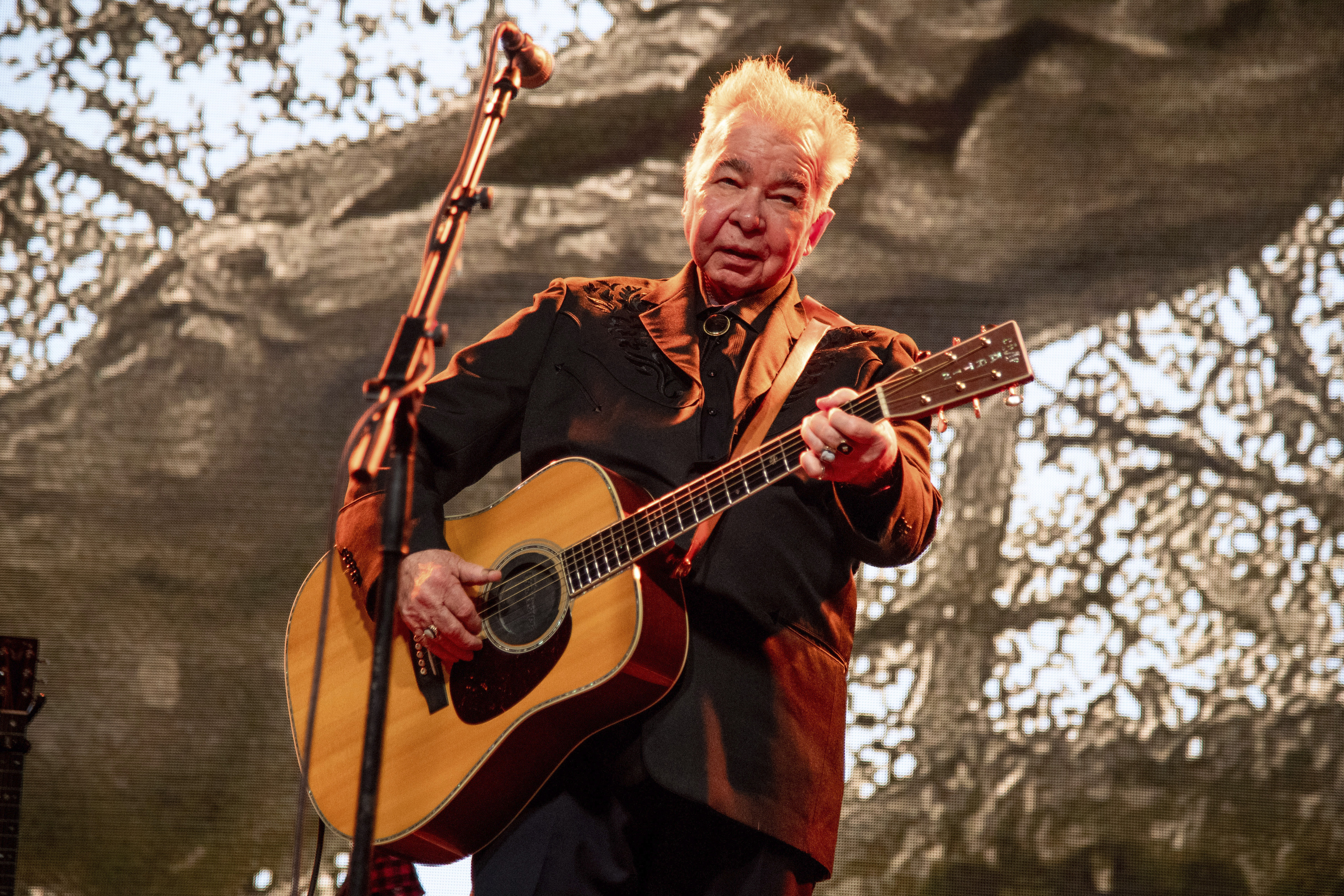 John Prine performs at the Bonnaroo Music and Arts Festival in Manchester, Tenn. on June 15, 2019.
