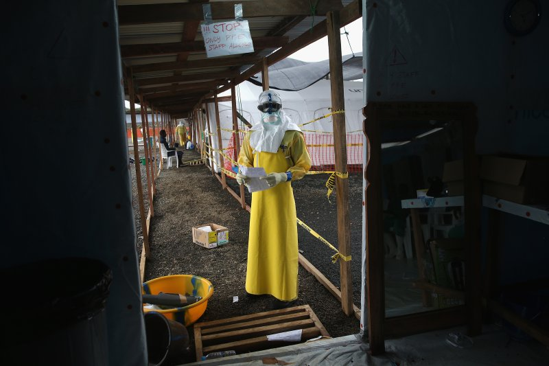 A staffer for Doctors Without Borders (MSF) stands in protective clothing in the new MSF Ebola treatment center on August 21, 2014 near Monrovia, Liberia.