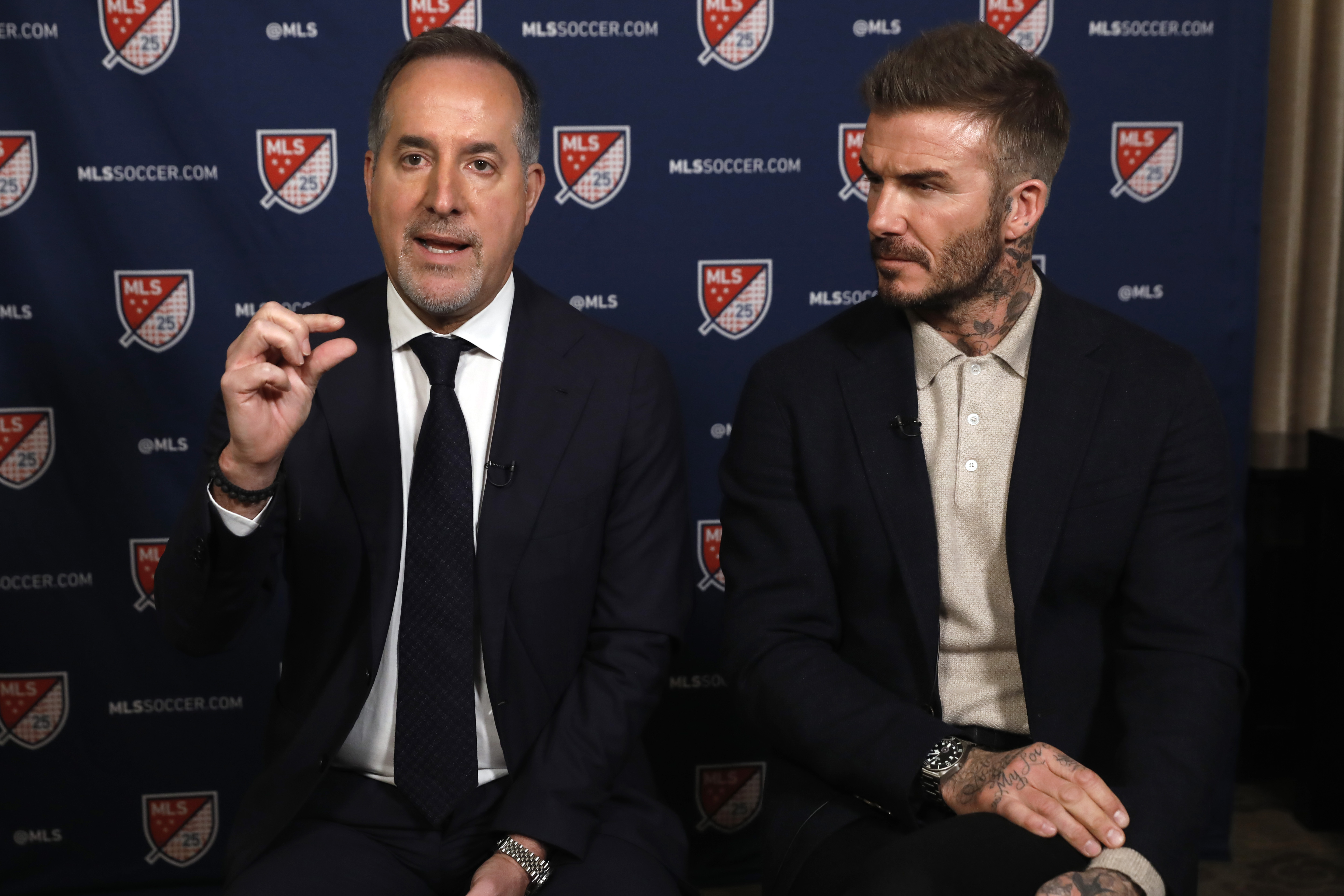 Inter Miami CF co-owners Jorge Mas, left, and David Beckham, are interviewed during the Major League Soccer 25th Season kickoff event, in New York, on Feb. 26, 2020.