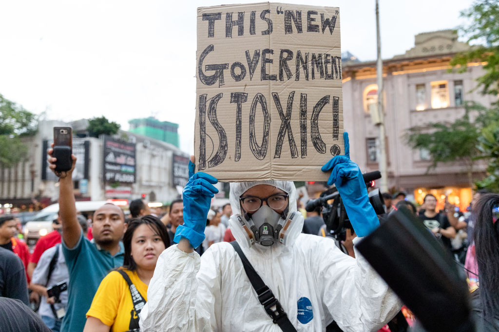 Demonstrators hold placards during a protest against Malaysia's newly sworn in prime minister, Muhyiddin Yassin in Kuala Lumpur on March 1, 2020.