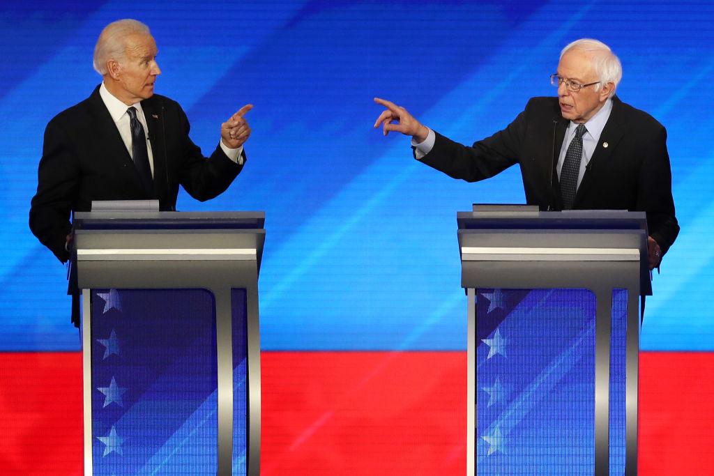Democratic presidential candidates former Vice President Joe Biden and Vermont Sen. Bernie Sanders participate in the Democratic presidential debate on Feb. 07, 2020 in Manchester, New Hampshire.