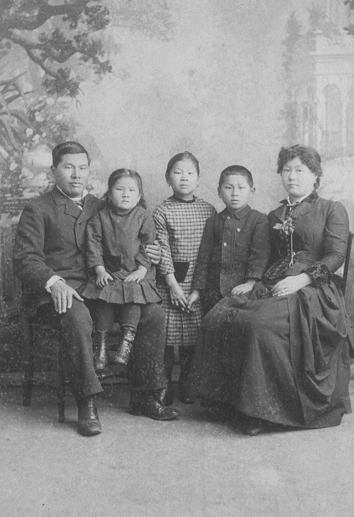 An 1884 portrait of the Tape family, including Joseph Tape, Emily Tape, Frank Tape, Mamie Tape, and Mary Tape.