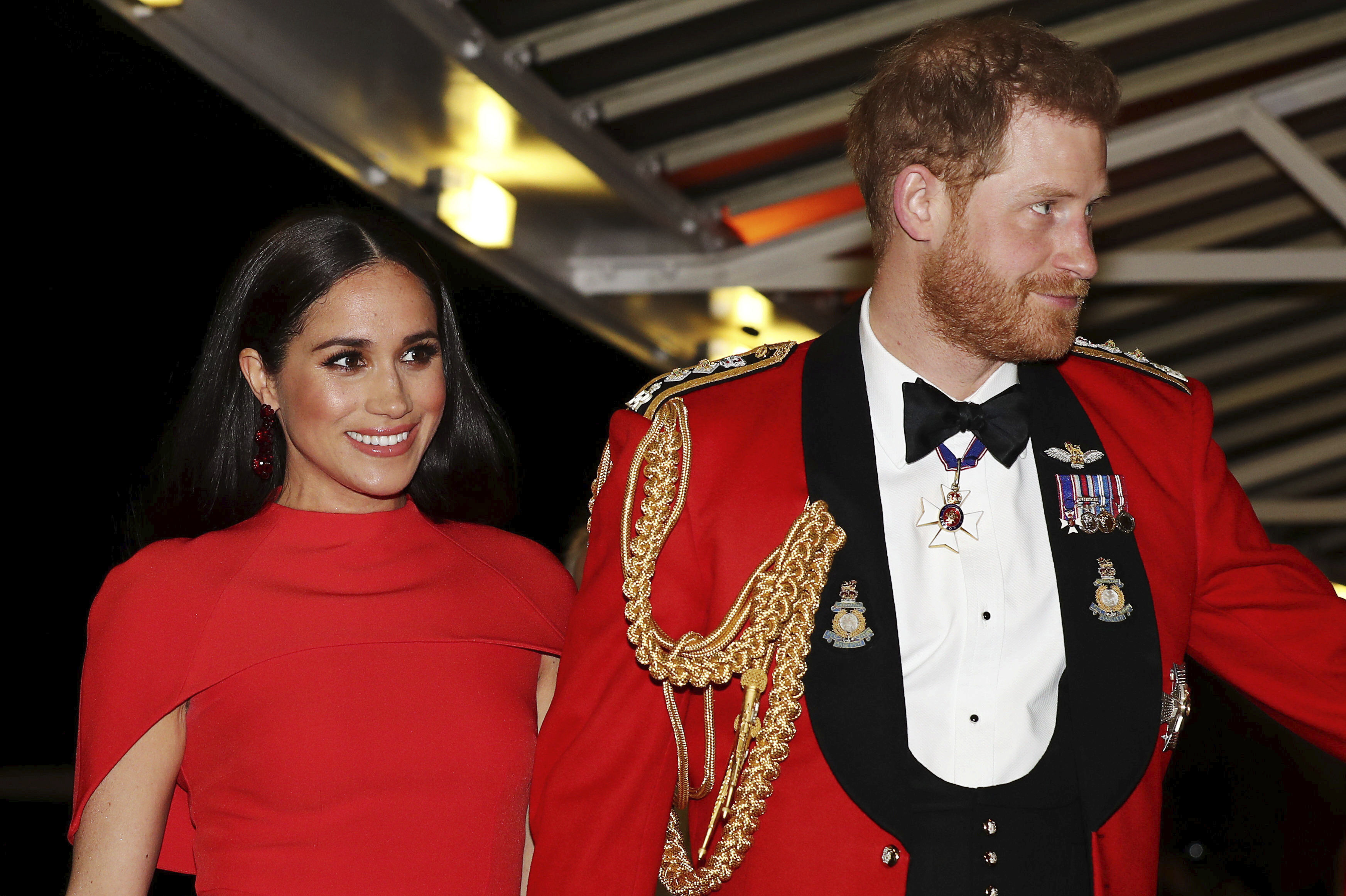 In this March 7, 2020 file photo, Britain's Prince Harry and Meghan, Duchess of Sussex arrive at the Royal Albert Hall in London.
