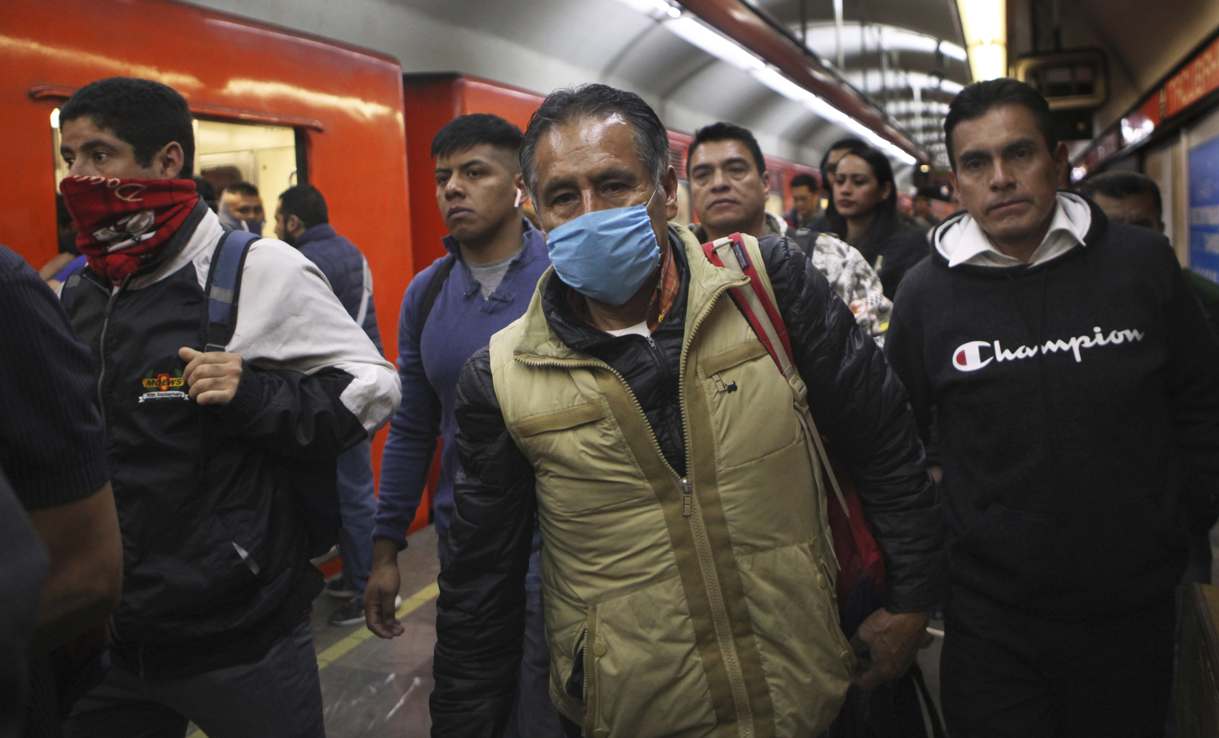 A commuter wears a protective mask as a precaution against the spread of the new coronavirus in the metro in Mexico City on March 19, 2020.