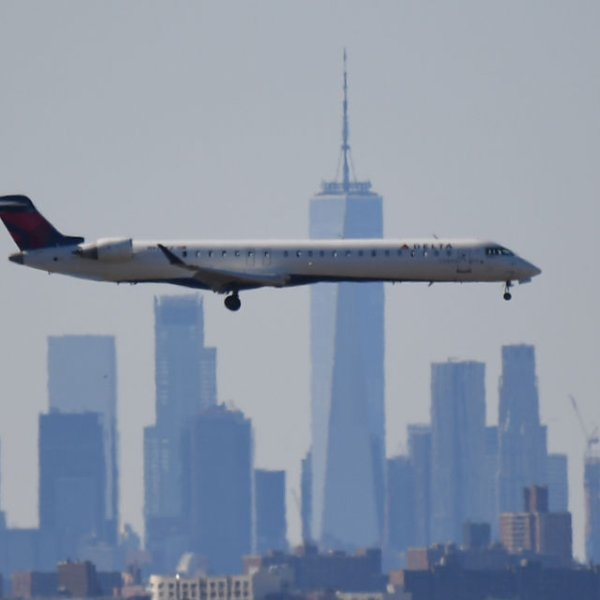 A plane from Delta Air Lines is seen above the skyline of Manhattan before it lands at JFK airport on March 15, 2020 in New York City.