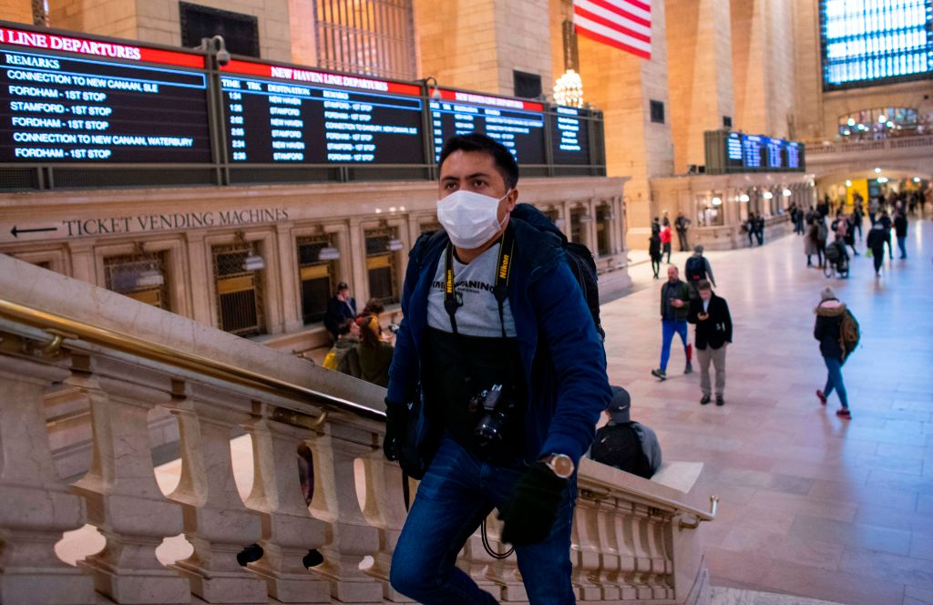 A man wears a face mask as he walks inside Grand Central Station in New York City on Mar. 8, 2020.
