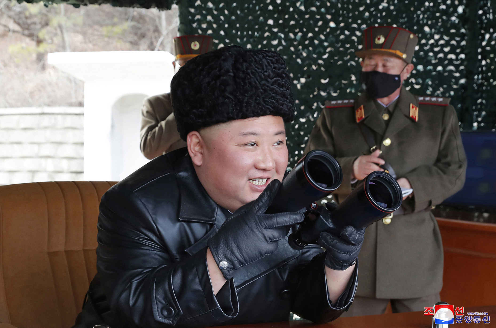 In this photo provided by the North Korean government, North Korean leader Kim Jong Un inspects a military drill at undisclosed location in North Korea on Monday, March 2, 2020.