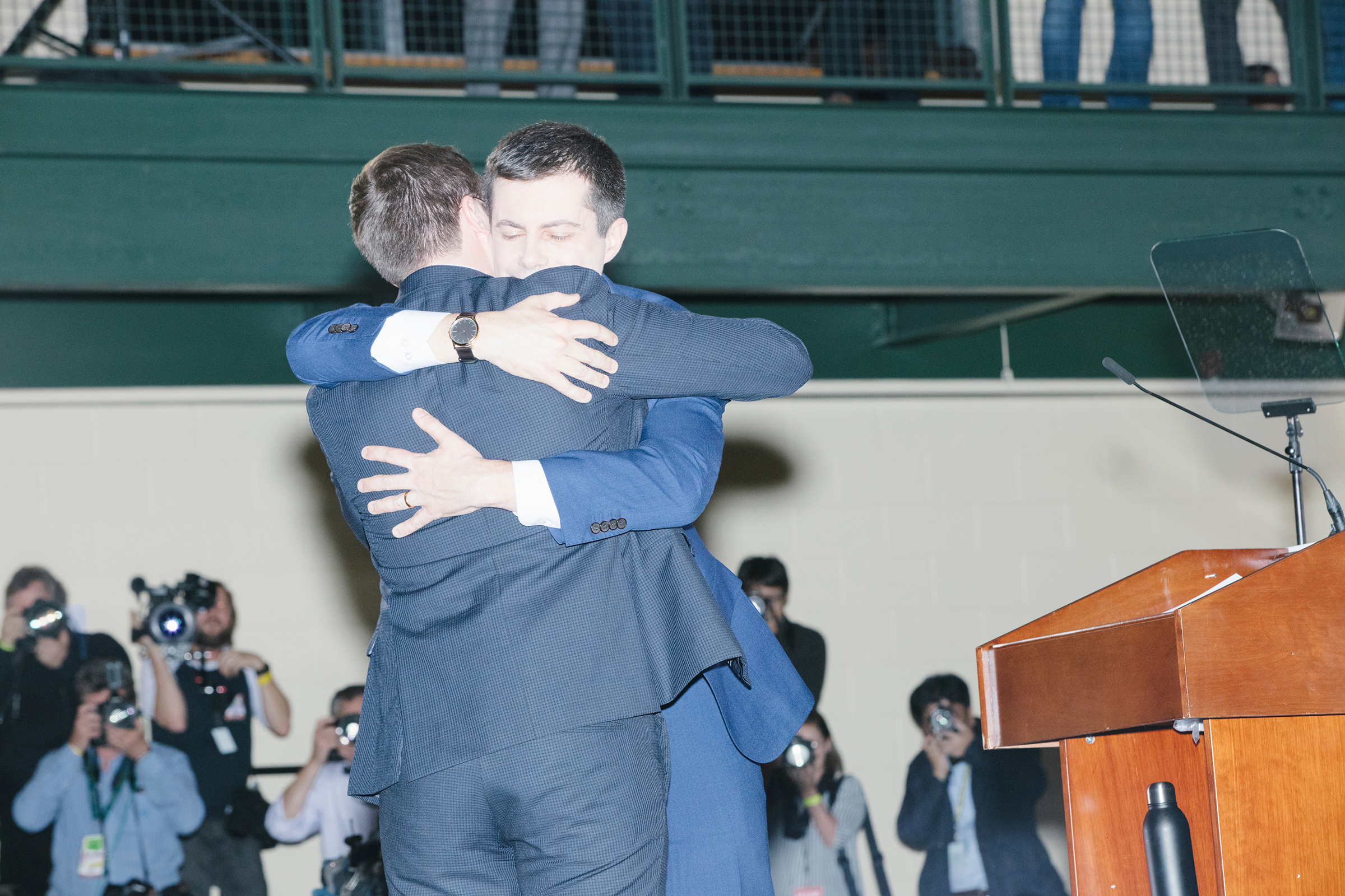 Pete Buttigieg embraces husband Chasten at a rally in Nashua, N.H., on Feb. 11, 2020.