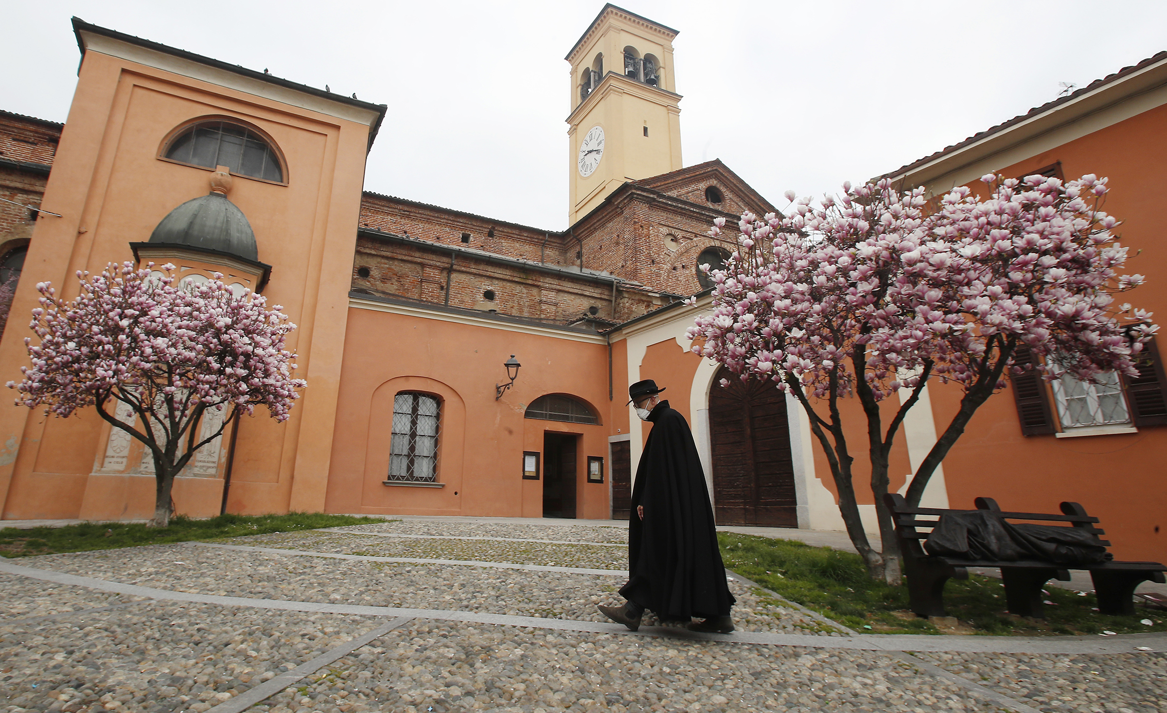 A priest walks in Codogno, Italy, on March 12, 2020.