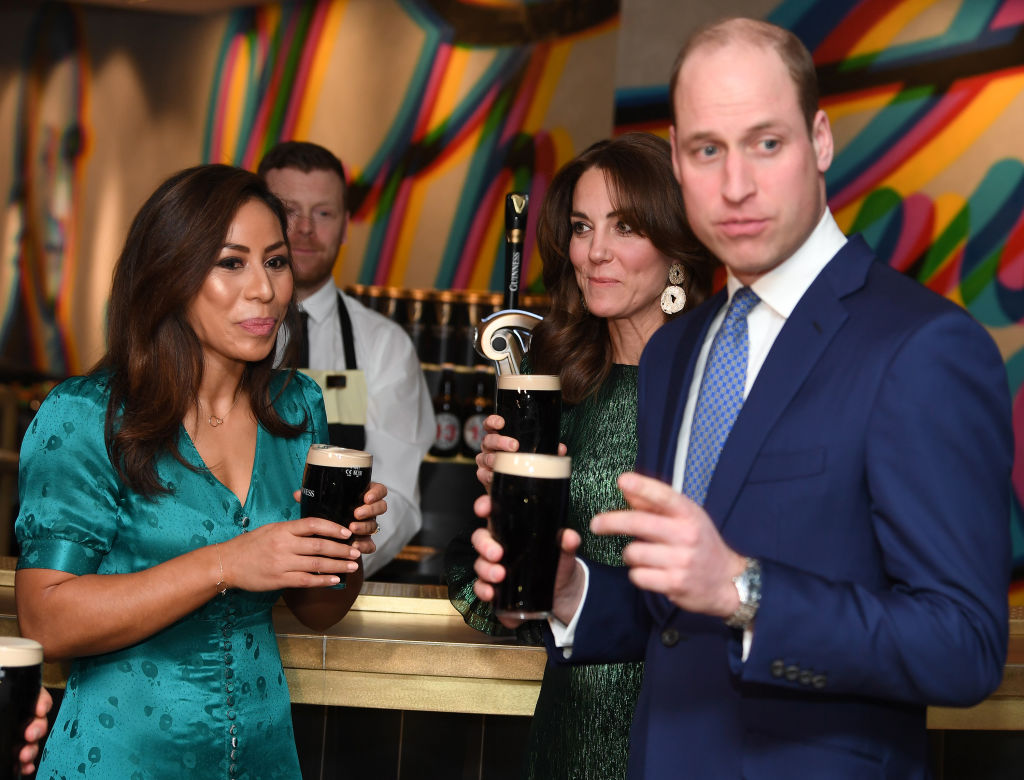 Catherine, Duchess of Cambridge and Prince William, Duke of Cambridge drink a Guinness at a reception hosted by the British Ambassador to Ireland Robin Barnett at the Guinness Storehouse's Gravity Bar during day one of their visit to Ireland on March 03, 2020 in Dublin, Ireland.