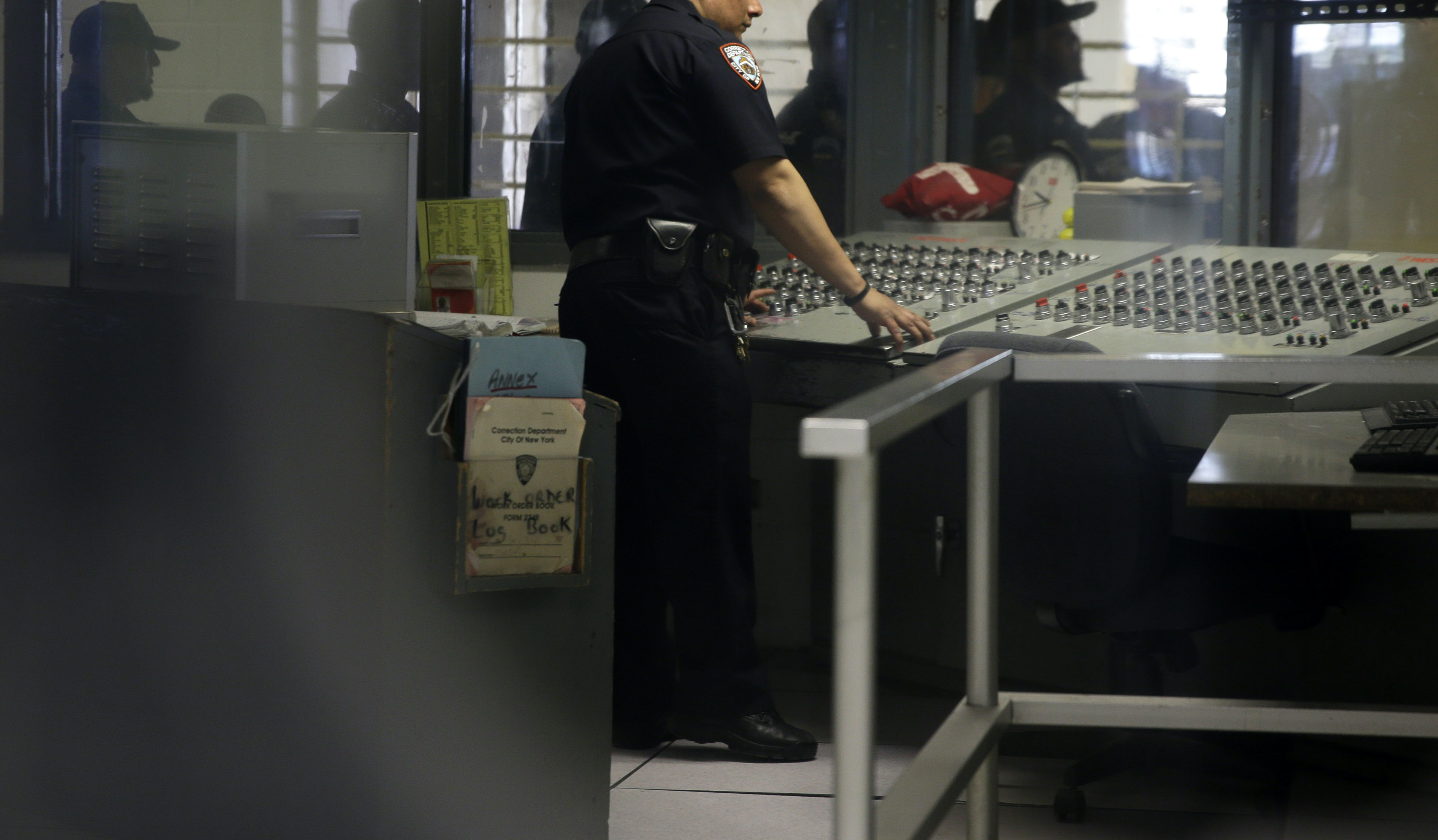 A corrections officer mans a security post on March 12, 2015 in an enhanced supervision housing unit on Rikers Island in New York City.