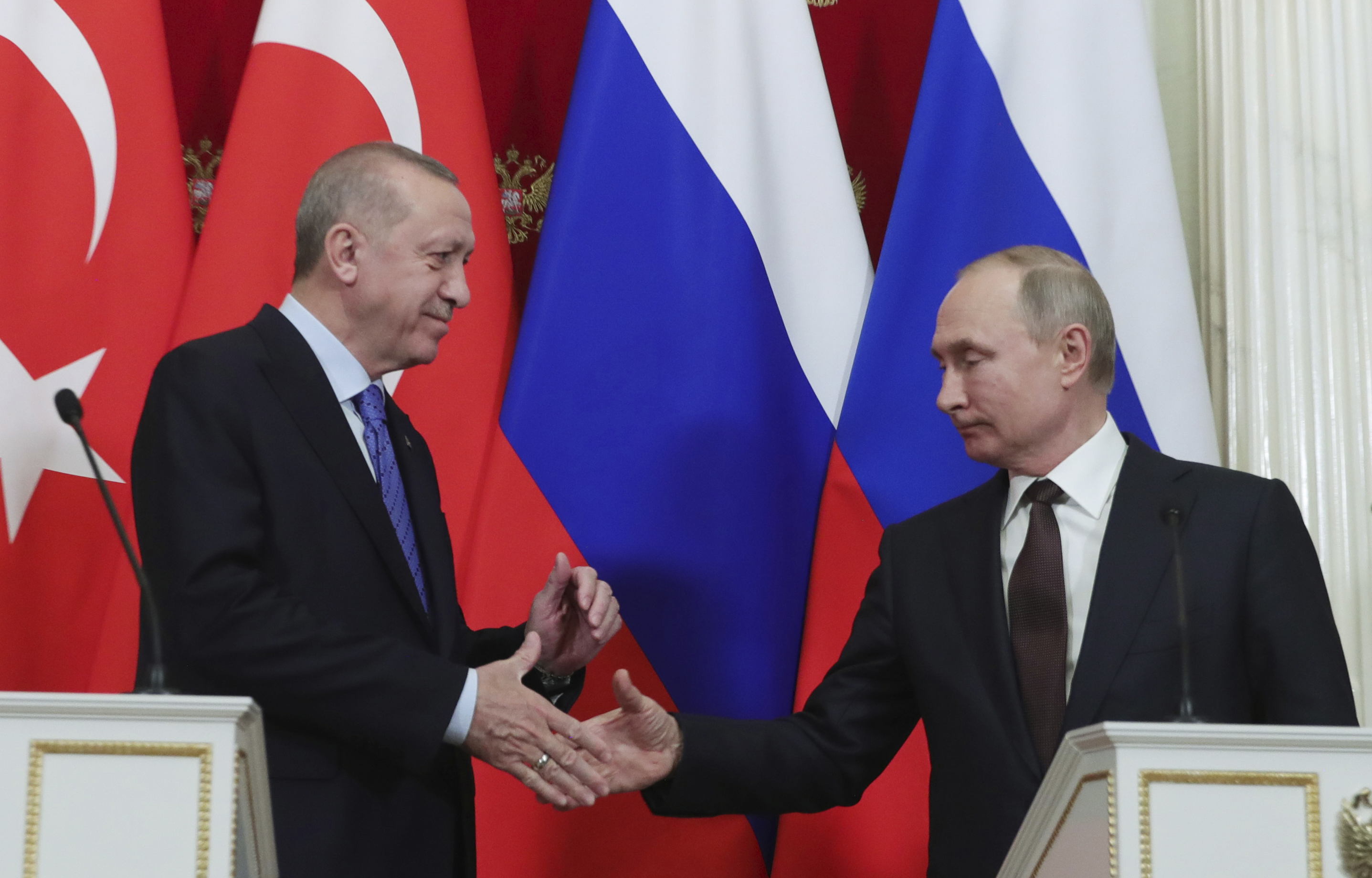 Russia's President Vladimir Putin, right, and Turkish President Recep Tayyip Erdogan shake hands after a joint news conference followed six-hour talks in the Kremlin, in Moscow, Russia on March 5, 2020.