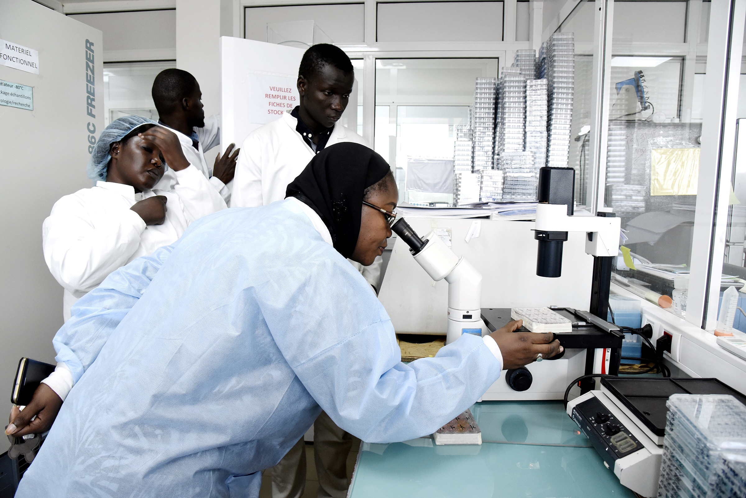 Scientific staff members work in a secure laboratory, researching the coronavirus, at the Pasteur Institute in Dakar, Senegal, on Feb. 3, 2020.