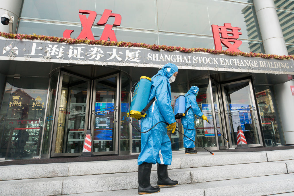 Medical workers spray antiseptic outside of the main gate of Shanghai Stock Exchange Building on Feb. 03, 2020 in Shanghai, China.