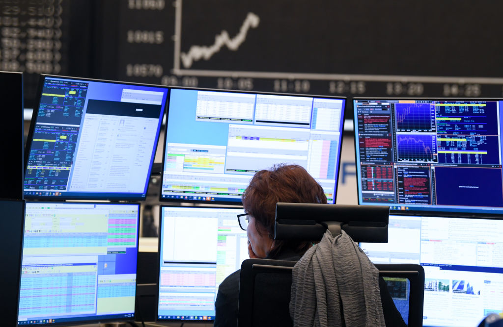 A stock trader watches her monitors on the trading floor of the Frankfurt Stock Exchange in Frankfurt on March 9, 2020.