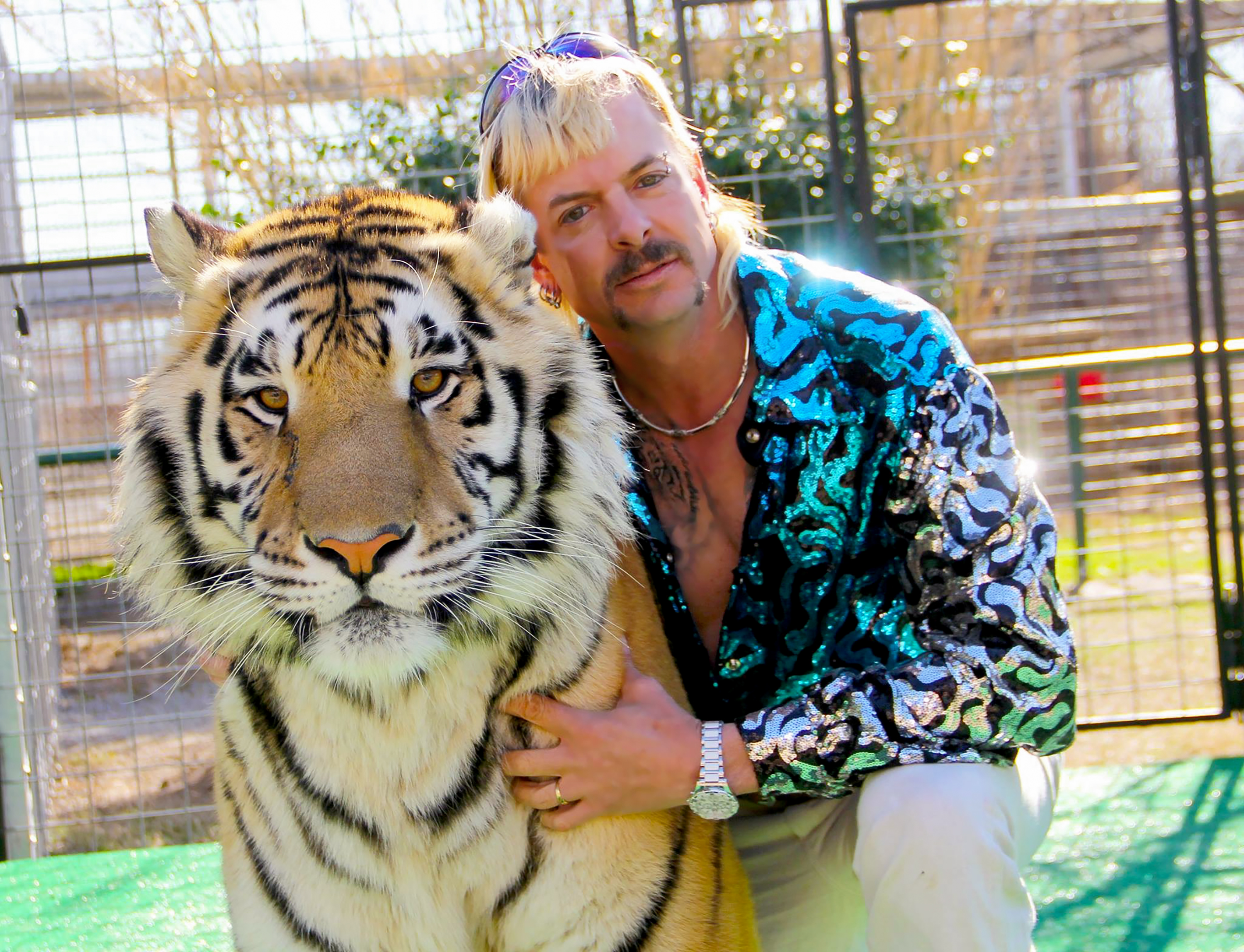 Joe Exotic poses with a tiger in 'Tiger King'