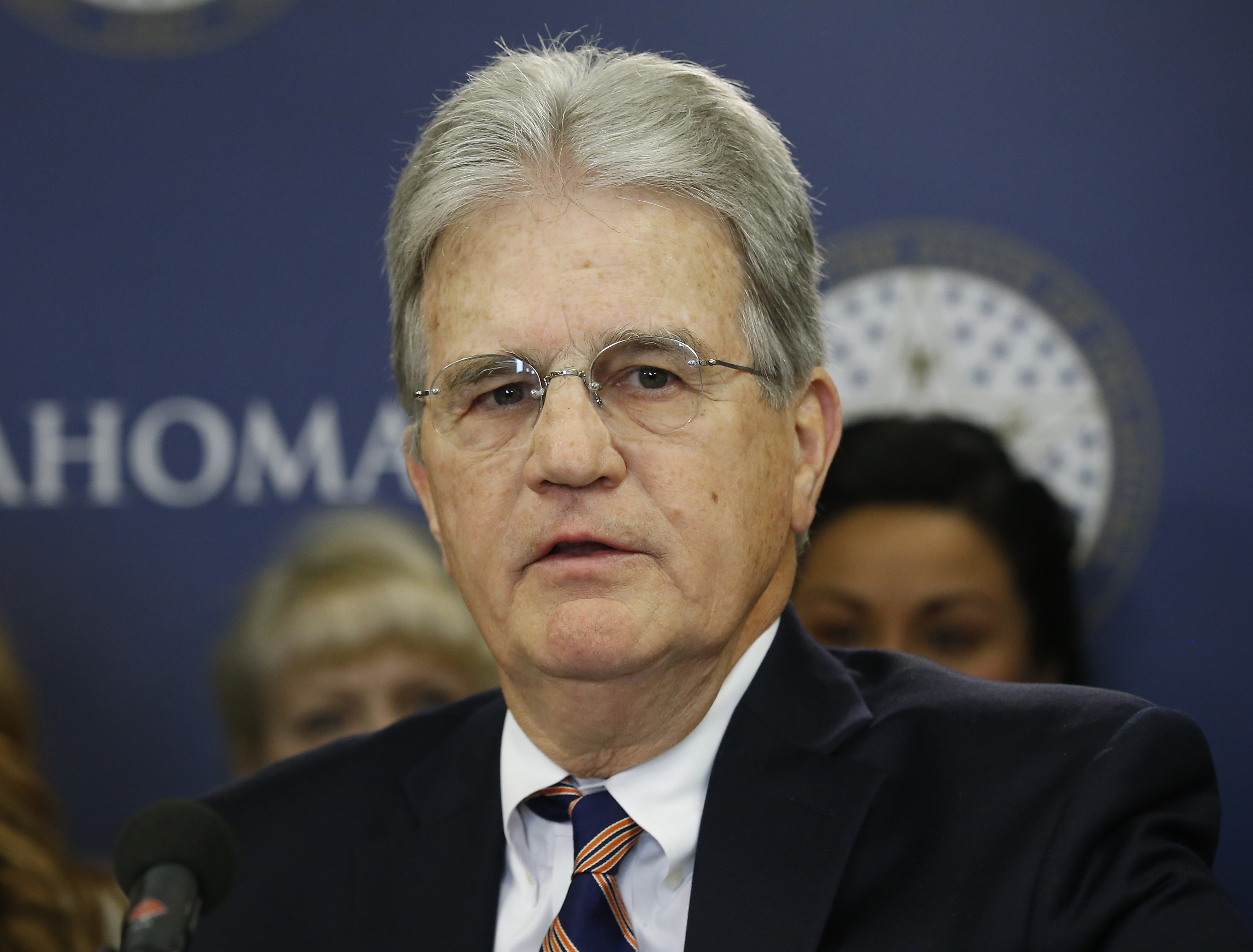 Former U.S. Sen. Tom Coburn speaks at a news conference in Oklahoma City, Okla., on March 28, 2018.