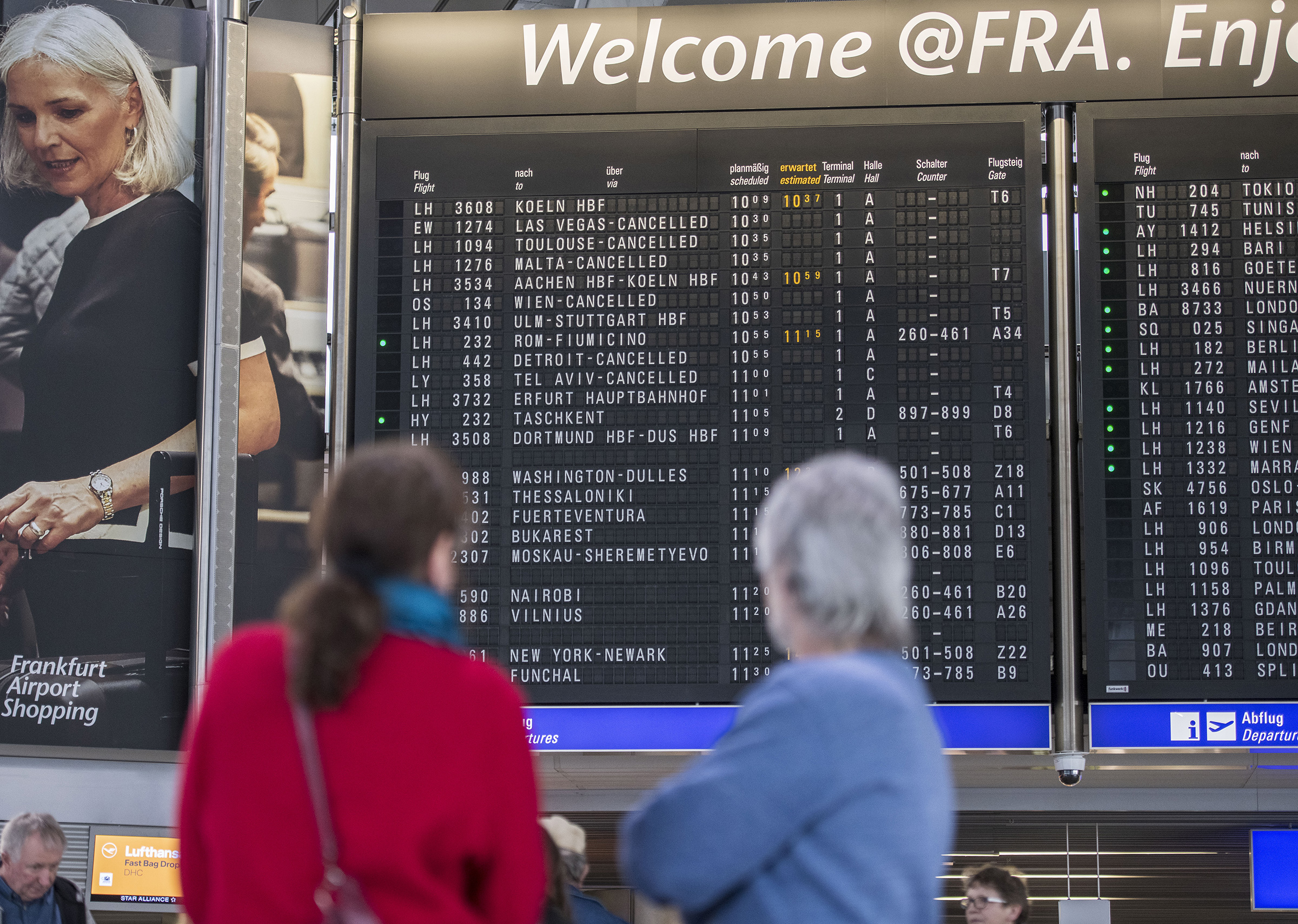 The destination board shows cancelled flights to America and Israel at Frankfurt Airport on March 12.