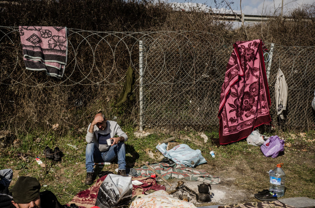 Migrants who came to Edirne, Turkey, to try and cross in Greece and after that to go to western Europe, gathered around a fire outside a bus station in Edirne on March 6, 2020.
