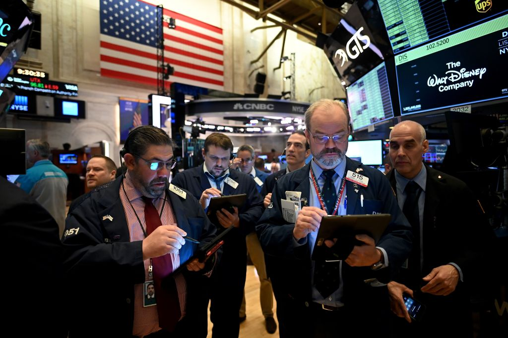 Traders work during the opening bell at the New York Stock Exchange (NYSE) on March 16, 2020 at Wall Street in New York City.
