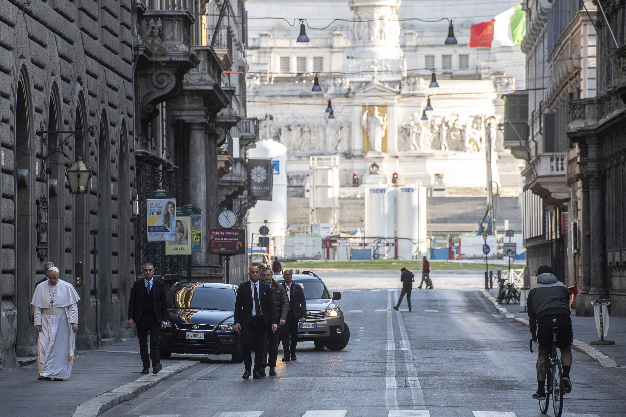 Pope Francis walks to reach S. Marcello al Corso church, where there is a miraculous crucifix that in 1552 was carried in a procession around Rome to stop the great plague, on March 15, 2020.